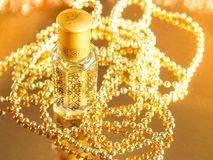 Gifts with Arabian perfume on golden background. Holidays decoration. Christmas, Birthday, Valentines Day. Stock Images