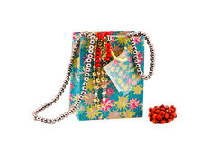 Gifts bag with assorted necklaces on white Royalty Free Stock Photography