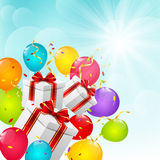 Gifts with balloons. On sunny background Stock Images