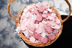 Gifts in the basket. Gift medallions are in the basket on the glass table Stock Photos
