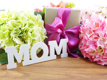 Gifts and beautiful bouquet of flowers for mother's day background Stock Image