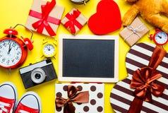 Gifts, blackboard, alarm clocks, camera, teddy bear Royalty Free Stock Photo