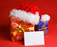 Gifts with blank sheet of paper Royalty Free Stock Photography
