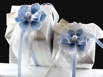 Gifts with blue flowers. Two white gifts with blue flowers on a black background royalty free stock photography