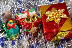 Gifts on blue and silvery tinsel Stock Photography