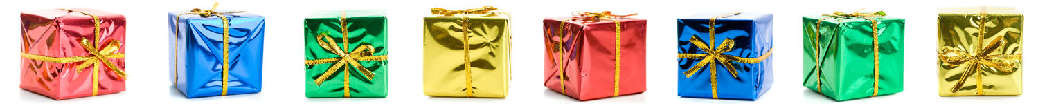 Gifts: Border Row Of Tiny Wrapped Gifts. Series of miniature, colorful gift boxes, some on colored backgrounds, some on white Royalty Free Stock Images