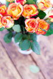 Gifts bouquet of roses on the table. Royalty Free Stock Images