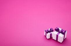 Gifts with bows on pink Royalty Free Stock Image