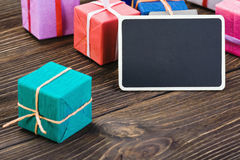 Gifts in the box and blackboard Stock Photos