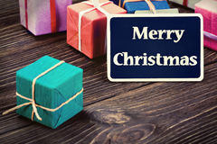 Gifts in the box and blackboard Royalty Free Stock Photo