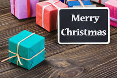 Gifts in the box and blackboard Stock Images