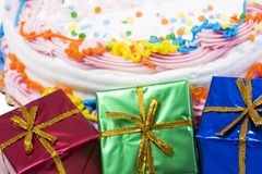 Gifts boxes with cake stock photos