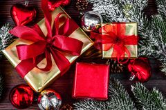 Gifts boxes with fir branches on wooden background top view Royalty Free Stock Photo