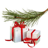 Gifts in boxes lie beneath of the fir branch, isolated on a whit royalty free stock photos