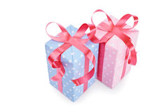 Gifts for a boy and a girl. Close-up shot of two gifts, one blue for a boy and one pink for a girl, isolated on white background Royalty Free Stock Photo