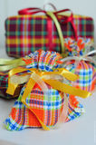 Gifts. In bright packing with braid, colorful yellow orange, white background Royalty Free Stock Photos