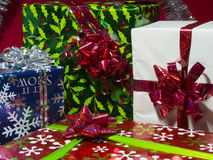 Gifts. Brightly colored gifts with red backdrop royalty free stock photography