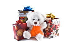 Gifts and bruin. Are isolated on a white background Stock Images