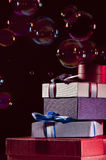 Gifts and bubbles Stock Photography