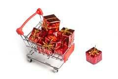 Gifts in the buyer`s basket. Full shopping cart. White isolated background. The concept of gifts and purchases before the New Yea