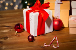 Gifts, candies and christmas balls on wooden board Stock Image