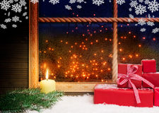 Gifts, candle and snowflakes Stock Photos
