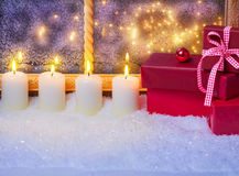 Gifts and candles in the window Royalty Free Stock Photography
