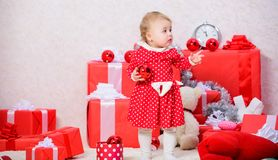 Gifts for child first christmas. Christmas activities for toddlers. Christmas miracle concept. Things to do with. Toddlers at christmas. Little baby girl play royalty free stock images