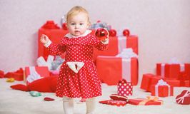 Gifts for child first christmas. Things to do with toddlers at christmas. Little baby girl play near pile of gift boxes. Family holiday. Christmas activities royalty free stock photo