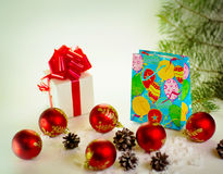 Gifts with Christmas balls Stock Photos