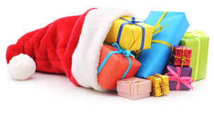 Gifts in christmas cap. Royalty Free Stock Photography