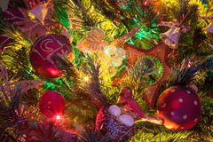 Gifts and Christmas decorations. Next to a glowing Christmas tree stock photography