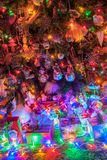 Gifts and Christmas decorations. Next to a glowing Christmas tree royalty free stock images