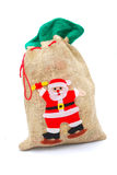Gifts in Christmas gunny sack Royalty Free Stock Photography