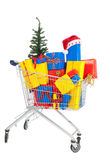 Gifts for Christmas in shopping cart Royalty Free Stock Image
