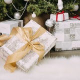 Gifts at Christmas tree Stock Photo