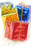 Gifts close up. Colorful christmas gifts isolated of white snow Royalty Free Stock Photography