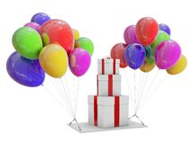 Gifts on color balloons. Stock Photo