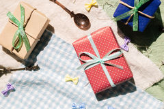 Gifts on colorful fabric background. Top view Royalty Free Stock Photo