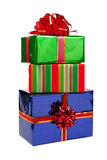 Gifts in colorful packages with bows. Royalty Free Stock Images