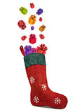 Gifts coming out of red christmas sock Stock Photos