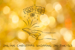 Gifts coming out of smartphone, with text Online Xmas shopping o Royalty Free Stock Photos