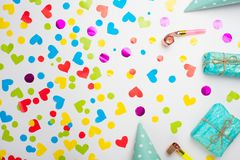 Gifts with confetti for the holiday. Top view with an empty place for inscription or advertising.  royalty free stock photo