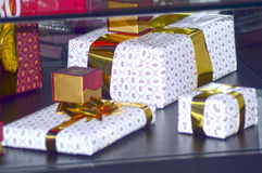 Gifts covered with gold ribbon X International Exhibition of jewelery and watch brands JUNWEX Moscow Royalty Free Stock Photos