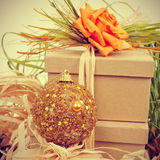 Gifts decorated with natual ornaments and christmas ball, with r Royalty Free Stock Photo