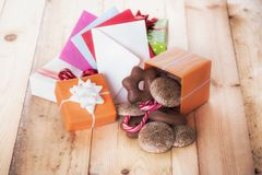 Gifts and envelopes on wooden table Stock Image