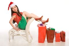 Gifts for everybody. Asian female with Christmas gifts of different sizes Royalty Free Stock Photo
