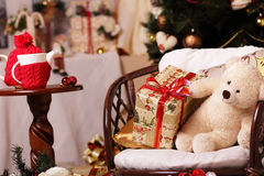 Gifts, fir-tree, tea, bear, smile. Composition on a new-year and Christmas theme. Gladness, warmly, comfort, holiday in a house Royalty Free Stock Photography