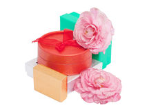 Gifts and flowers around a red box Royalty Free Stock Images