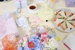 Gifts, Food And Drink Arranged On Table Royalty Free Stock Images